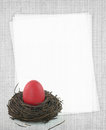 Red Easter egg and blank paper recipe card Stock Photo