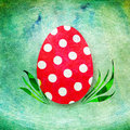 Red easter egg polka dots green grungy background vintage scratchy feel Royalty Free Stock Images
