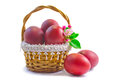 Red easter eggs in a basket on a white background three painted are beautifully decorated with wicker presented Stock Photos