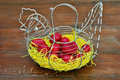 Red easter eggs chicken basket Royalty Free Stock Photography