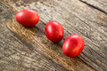 Red easter eggs on old wood table Stock Photography