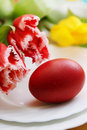 Red egg passover holiday still life eggs flowers and cake Royalty Free Stock Images