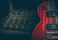 Red electric guitar and classic amplifier on a dark background Royalty Free Stock Photo