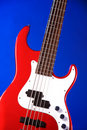 Red Electric Guitar Isolated On Blue Royalty Free Stock Photo
