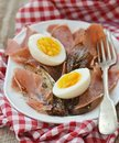 Red endive ,eggs and warm salad Stock Photos