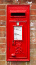 Red english letterbox a traditional mounted in a brick wall in the town of knutsford cheshire Royalty Free Stock Photography