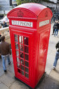 Red english telephone booth and people around it Royalty Free Stock Photography