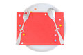 Red envelop with heart shaped fork and spoon on top of white pla plate isolated Royalty Free Stock Image