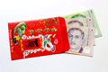 Red envelop and lucky money us dollar envelopes packets are wrapped in paper given to kids from their parents grandparents Royalty Free Stock Photos