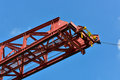 Red erection truss heavy equipment in construction site with clear blue sky in sunny day Royalty Free Stock Photo