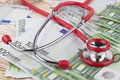 Red on euros stethoscope pile of euro banknotes Stock Image