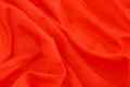 Red fabric crumpled shiny bright Royalty Free Stock Photo