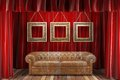 Red fabric curtain frames sofa Stock Photography