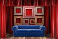 Red fabric curtain with frames and sofa Royalty Free Stock Images