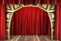 Red fabric curtain on golden stage Stock Photography