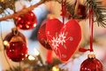 Red fabric heart at Christmas tree Royalty Free Stock Photo