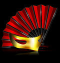 Red fan and golden mask dark background the with half Stock Images