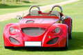 Red fast cabriolet car Royalty Free Stock Image