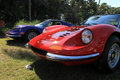 Red ferrari dino line up classic gt sports car in next to violet gt sports car at cavallino Royalty Free Stock Image