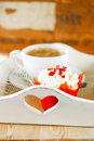 Red festive muffin and coffee, on wooden tray Royalty Free Stock Photos