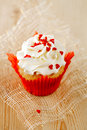 Red festive muffin with heart candy Stock Image