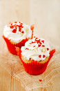 Red festive muffins with heart candy and  wood Royalty Free Stock Photo