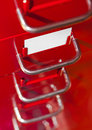 Red file cabinet with blank card Royalty Free Stock Photo