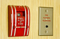 Red fire alarm and fighter telephone on the wooden wall Royalty Free Stock Photo