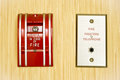 Red fire alarm on the wooden wall Stock Photos