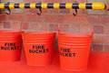 RED FIRE BUCKETS IN A ROW Royalty Free Stock Photo