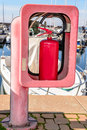 Red fire extinguisher. Royalty Free Stock Photo