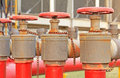 Red fire hose valve Royalty Free Stock Photo