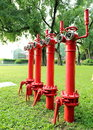 Red fire hydrant fire main pipe for fire extinguishing typical on the lawn pipes prevention pipes fighting and Stock Photography