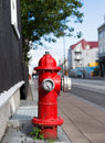 Red fire hydrant on a street Stock Photo