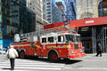 Red fire truck in new york city on duty at fifth avenue manhattan usa Royalty Free Stock Images