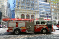 Red fire truck in new york city on duty at fifth avenue manhattan usa Stock Photo