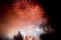 Red fireworks exploding at night Stock Images