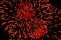 Red fireworks explosion on black sky background Royalty Free Stock Photo