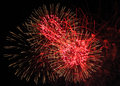 Red fireworks trio close up during riverfest Royalty Free Stock Image