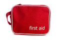 Red first aid kit on white a a background Royalty Free Stock Photo