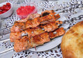 Red fish fried on skewers Royalty Free Stock Photo