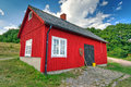 Red fisherman house on the coast of Sweden Stock Photos