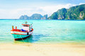 Red fishing boat on an exotic beach, Thailand Royalty Free Stock Photo