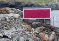 Red fishing stage on rugged Fogo Island coastline Royalty Free Stock Photo