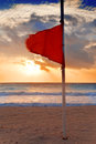 Red flag on the beach close up Royalty Free Stock Photo