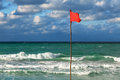 Red flag beach storm Stock Photos