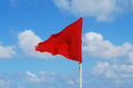 Red flag beach Royalty Free Stock Photo