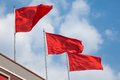 Red flag with blue sky Royalty Free Stock Photography