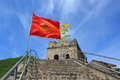 Red flag on the great wall badaling china image of a against a blue sky remnant at editorial use only Royalty Free Stock Image