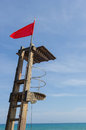 Red flag at lifeguard post Royalty Free Stock Photo